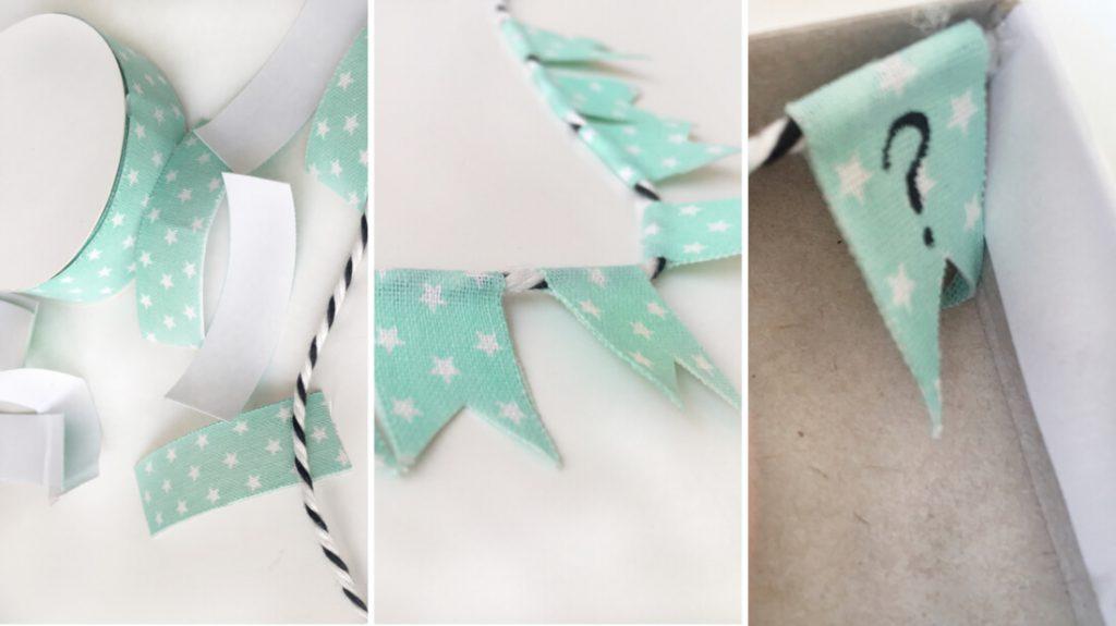 Aus einem schönen Stoffband und einem Garn lässt sich eine hübsche Wimpelkette mit Schriftzug basteln