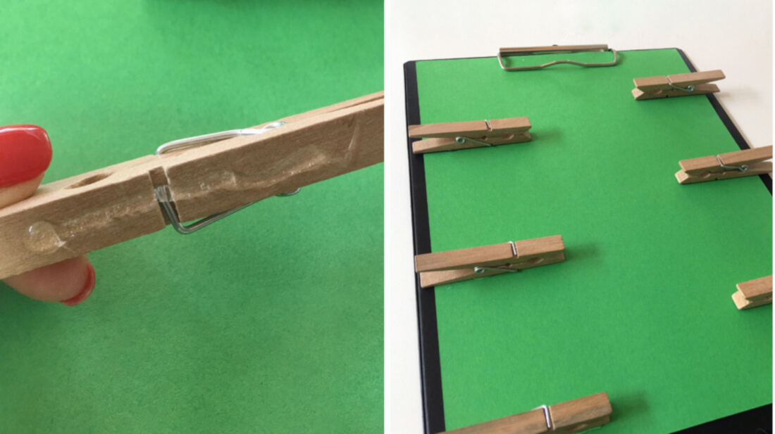 Das Klemmbrett wir aus einen Plastikklemmbrett, Tonpapier und Wäscheklammern aus Holz gebastelt